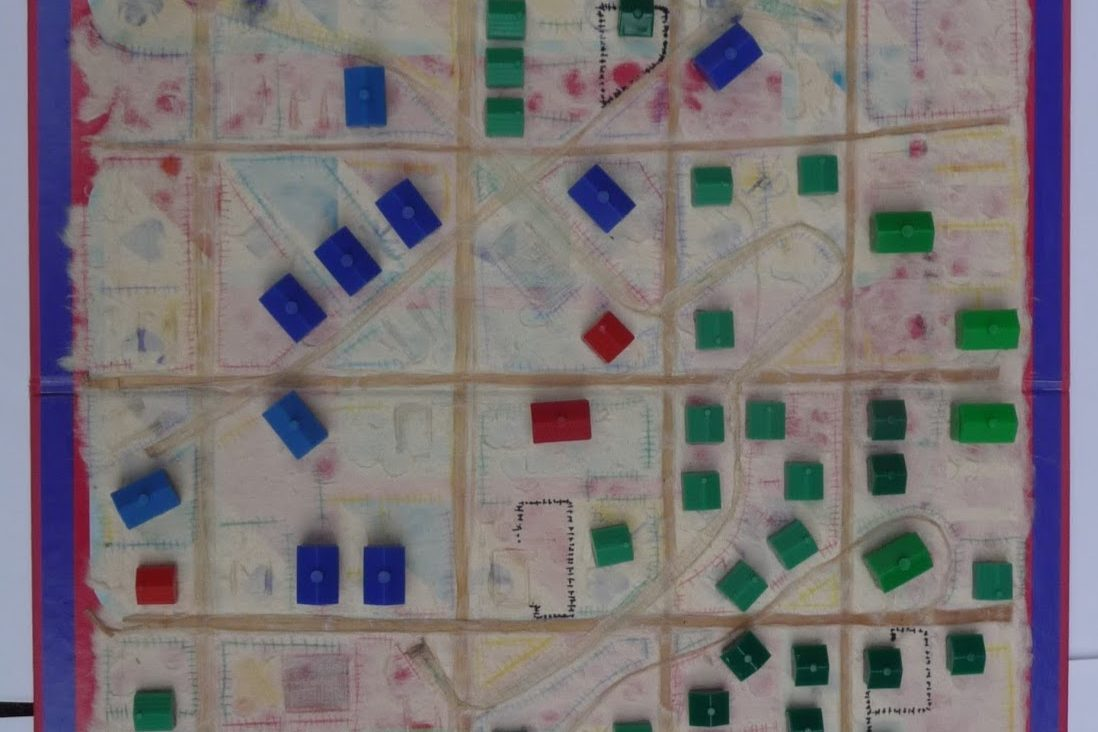 Gameboard and Monopoly houses