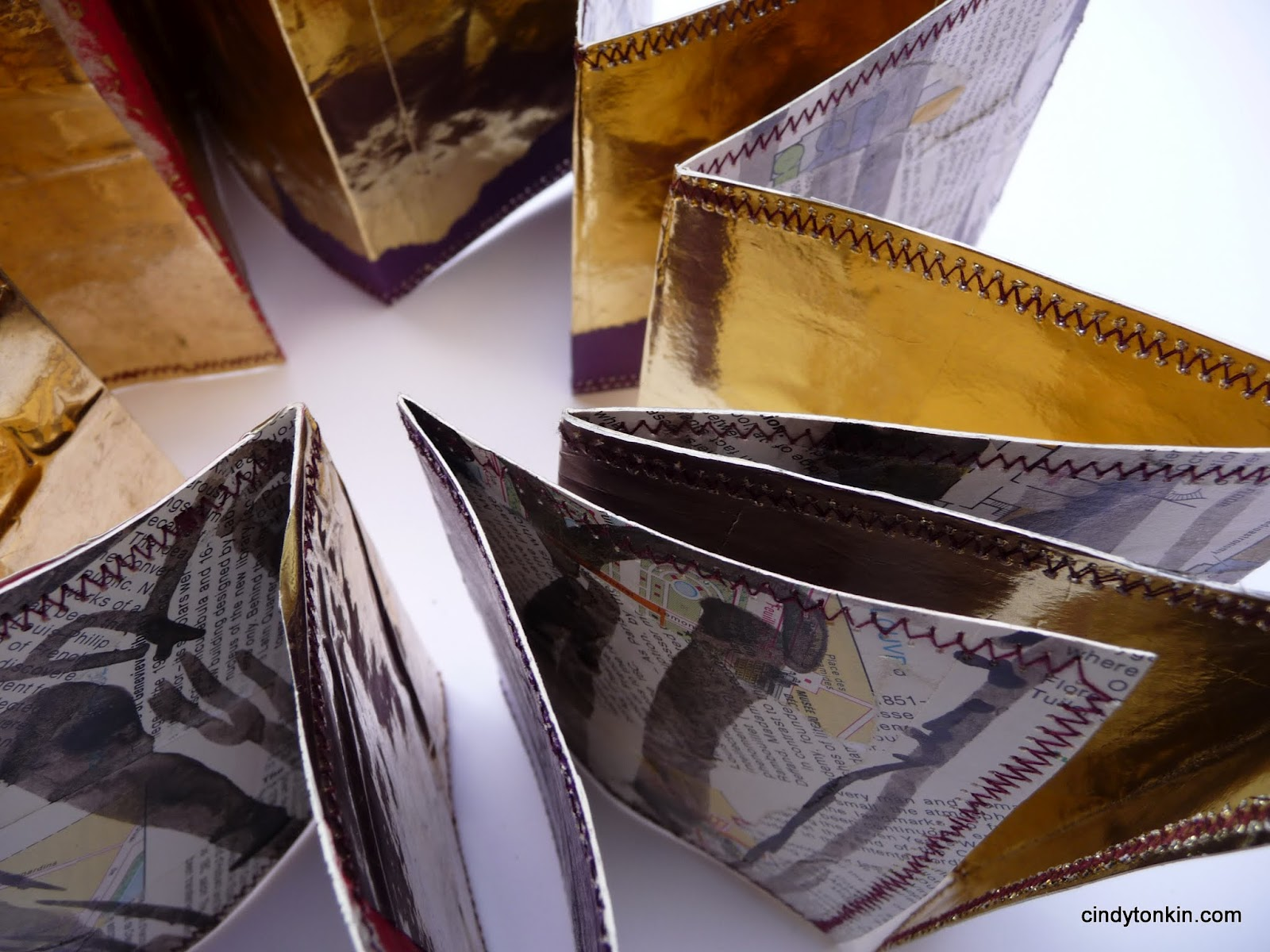 Concertina from collaged paris maps with gold backing