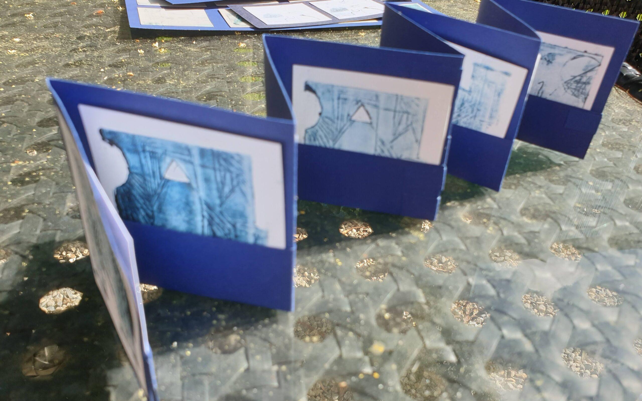 Open Press Blue concertina